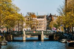 Common Dutch Houses and Houseboats On Amsterdam Canal In Autumn Royalty Free Stock Photo