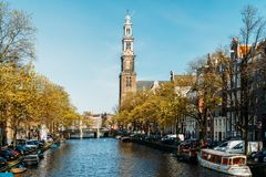 Common Dutch Houses and Houseboats On Amsterdam Canal In Autumn Stock Image