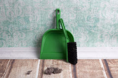 Common house dust. On a floor, dustpan and brush set Royalty Free Stock Photos
