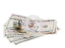 Common  lamp bulb on dollars Stock Photography