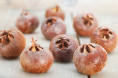 Common medlar fruits. On wooden table. Mespilus germanica Stock Photos