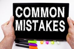 Common Mistakes text written on tablet, computer in the office with marker, pen, stationery. Business concept for Common DecisionM Stock Image