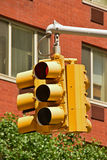 Common multi angle yellow traffic light. Common multi angle yellow old traffic light in North America usually used at busy and large crossroad Royalty Free Stock Photography