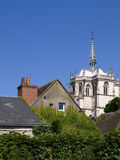 Common people and Nobility. Concept. One of the humble houses of Amboise with the Cathedal at background Stock Images