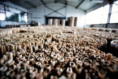 Common reed rolls stored in industrial storing facilities Royalty Free Stock Image