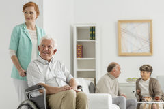 Common room at nursing home. With seniors Royalty Free Stock Photos