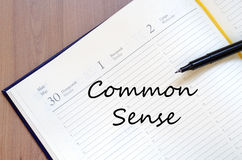Common sense write on notebook Stock Photography