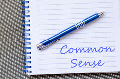 Common sense write on notebook Stock Images