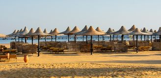 Rows of sun parasols and sunbeds on the beach. stock photography