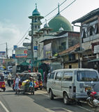 Common Sri Lankian crowded street with different transport and pedestrians on Dec 7, 2011 Stock Photo