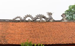 Common stone dragon on top of temple roof in Vietnam.  royalty free stock photo