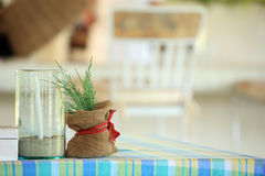 Common table setup with pine leaves and candle, Thailand Royalty Free Stock Images