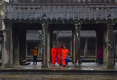 Visiting monks in Angkor Wat temple, Siem Reap Cambodia on a rainy day. stock image
