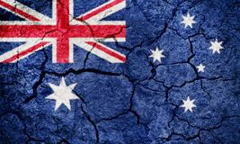 Commonwealth of Australia flag. Australia flag on dry earth ground texture background Royalty Free Stock Image