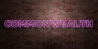 COMMONWEALTH - fluorescent Neon tube Sign on brickwork - Front view - 3D rendered royalty free stock picture. Can be used for online banner ads and direct Royalty Free Stock Image