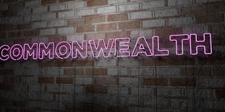 COMMONWEALTH - Glowing Neon Sign on stonework wall - 3D rendered royalty free stock illustration. Can be used for online banner ads and direct mailers Stock Images