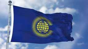 Commonwealth of Nations Waving Flag. Commonwealth of Nations flag waving against clear blue sky, close up,  with clipping path mask luma channel, perfect for Stock Image