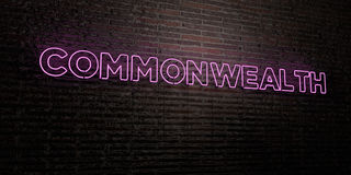 COMMONWEALTH -Realistic Neon Sign on Brick Wall background - 3D rendered royalty free stock image. Can be used for online banner ads and direct mailers Stock Photo