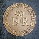 Commonwealth Walkway brass plaque. Commemorative Commonwealth Walkway brass plaque. Street sign set in the pavement, Glasgow, Scotland, UK stock photo