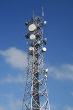 Comms Mast. Communications mast with numerous satellite dishes Royalty Free Stock Photography