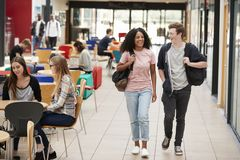 Communal Area Of Busy College Campus With Students stock photography