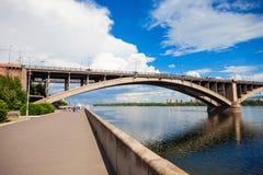 Communal bridge in Krasnoyarsk. Communal bridge is a automobile and pedestrian bridge across the Yenisei river in Krasnoyarsk, Russia Royalty Free Stock Photos
