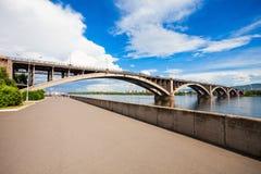 Communal bridge in Krasnoyarsk. Communal bridge is a automobile and pedestrian bridge across the Yenisei river in Krasnoyarsk, Russia Stock Photography
