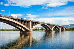 Communal bridge in Krasnoyarsk. Communal bridge is a automobile and pedestrian bridge across the Yenisei river in Krasnoyarsk, Russia Stock Image