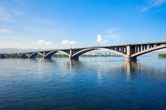 Communal bridge in Krasnoyarsk. Communal bridge is a automobile and pedestrian bridge across the Yenisei river in Krasnoyarsk, Russia Royalty Free Stock Photography