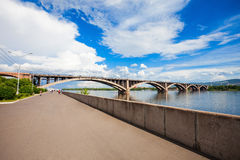 Communal bridge in Krasnoyarsk. Communal bridge is a automobile and pedestrian bridge across the Yenisei river in Krasnoyarsk, Russia Stock Photo