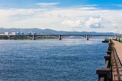 Communal bridge in Krasnoyarsk. Communal bridge is a automobile and pedestrian bridge across the Yenisei river in Krasnoyarsk, Russia Royalty Free Stock Photo