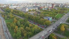 Communal Bridge over the river Kama in Perm. Span along the Kama River waterfront view of the city of Perm, the traffic on the bridge, the train rides stock video footage