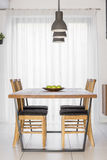 Communal table with chairs. Interior with wooden communal table, chairs and lamp Royalty Free Stock Photo