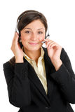 Communcations business woman holding her headset Stock Photo