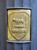 Commune of Rome Emblem, SPQR, Rome, Lazio, Italy. Brass Commune of Rome shield or emblem on a Rome public garbage or trash can. SPQR is an initialism of a phrase Stock Photos