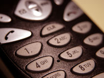 Communicate. Closeup of a mobile phone (focus on the digits royalty free stock photography