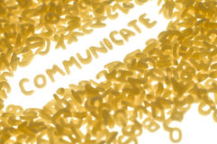 Communicate. Word COMMUNICATE created with food letters, white background Stock Photos