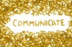 COMMUNICATE. Word COMMUNICATE made of food letters, white background Royalty Free Stock Images