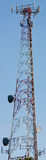 Communicate. High resolution communications tower vertical panaramic Royalty Free Stock Photo