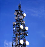Communicate. Telecommunication mast with blue sky background stock images