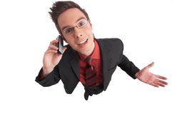 Communicate. Businessman talks on the phone with clipping path included Royalty Free Stock Photo
