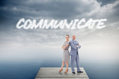 Communicate against cloudy sky over ocean Royalty Free Stock Image