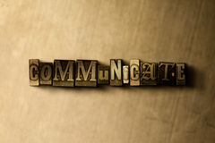 COMMUNICATE - close-up of grungy vintage typeset word on metal backdrop. Royalty free stock illustration.  Can be used for online banner ads and direct mail Royalty Free Stock Images