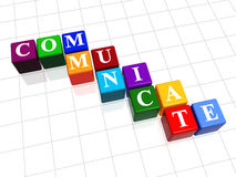 Communicate in colour 2. 3d colour boxes with text - communicate, word Stock Image
