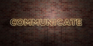 COMMUNICATE - fluorescent Neon tube Sign on brickwork - Front view - 3D rendered royalty free stock picture. Can be used for online banner ads and direct Royalty Free Stock Photos