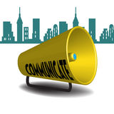 Communicate megaphone. Yellow megaphone with the text communicate written with black capital letters Royalty Free Stock Photography
