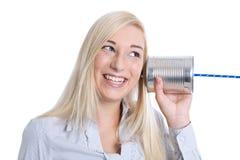 Communicatie of reclameconcept: het jonge geïsoleerd glimlachen wom Stock Foto