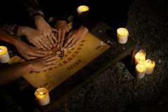 Communicating with ghosts through spiritual board Stock Images