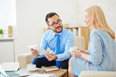 Communicating in office Stock Photography