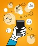 Communicating via modern smartphone Royalty Free Stock Image